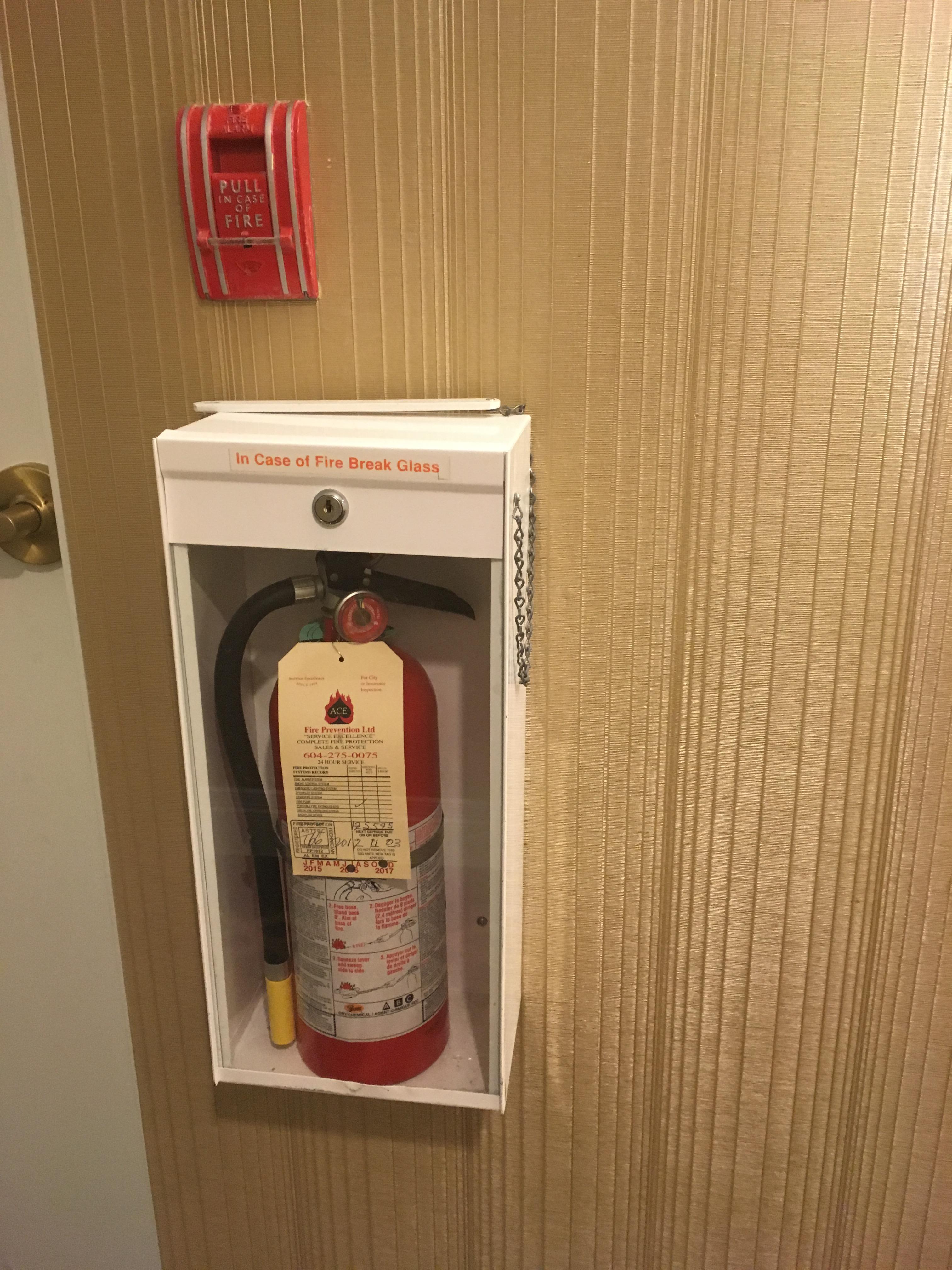vancouver hilton fire extinguisher, fire extinguisher glass case, extinguisher glass casket